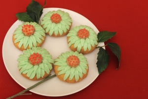 Frosted Doughnut Flowers Garnished With Leaves